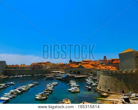Dubrovnik Croatia - June 07 2015: View on the fortress and marina in the old town of Dubrovnik Croatia. Dubrovnik is a UNESCO World Heritage site