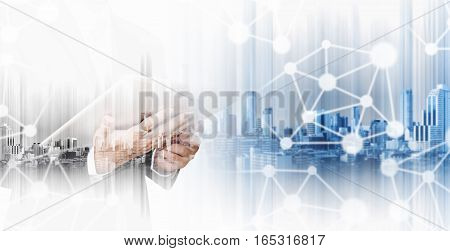 Double exposure businessman working on digital tablet with modern city, network communication technology concepts