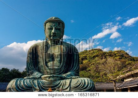 The Great Buddha Daibutsu in Tokyo, Japan statue sits in the front view