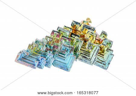 Artificially grown skeletal crystals of bismuth with tarnish isolated on a white background