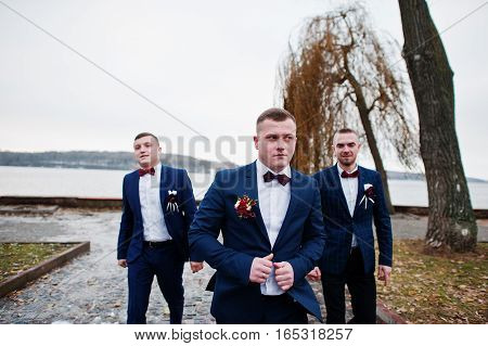 Groom With Best Mans At Cold Winter Wedding Day.