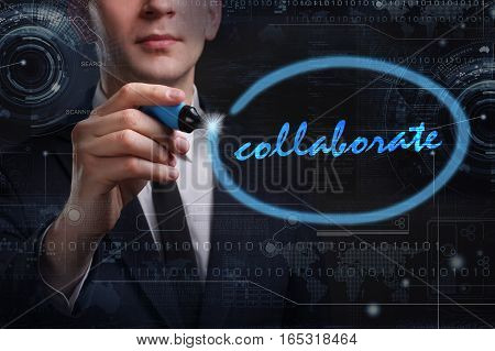 Business, Technology, Internet And Network Concept. Young Business Man Writing Word: Collaborate