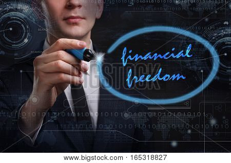 Business, Technology, Internet And Network Concept. Young Business Man Writing Word: Financial Freed