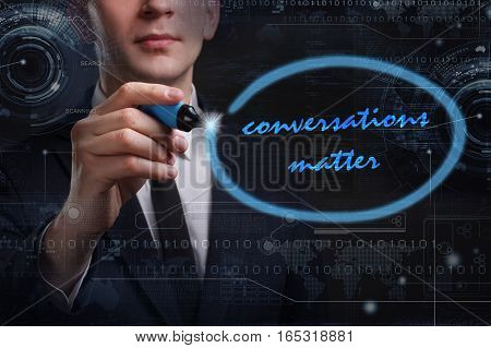 Business, Technology, Internet And Network Concept. Young Business Man Writing Word: Conversations M
