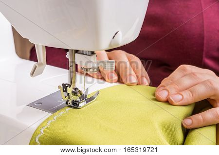 Fashion Woman Sews With Sewing Machine