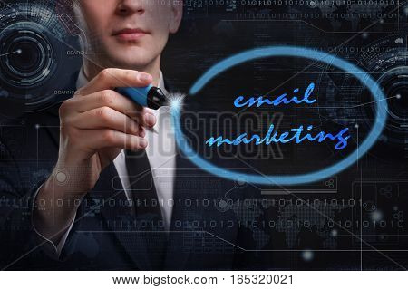 Business, Technology, Internet And Network Concept. Young Business Man Writing Word: Email Marketing