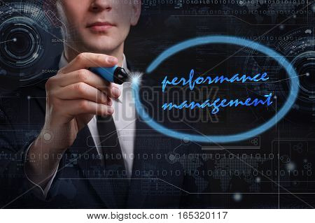 Business, Technology, Internet And Network Concept. Young Business Man Writing Word: Performance Man