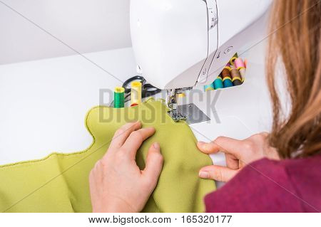 Fashion Woman Sews With Sewing Machine