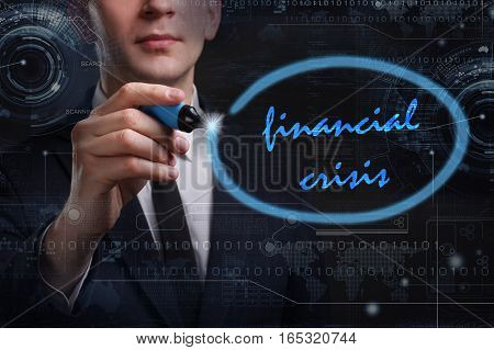 Business, Technology, Internet And Network Concept. Young Business Man Writing Word: Financial Crisi