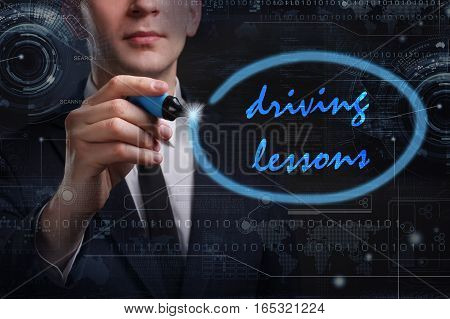 Business, Technology, Internet And Network Concept. Young Business Man Writing Word: Driving Lessons