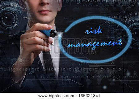 Business, Technology, Internet And Network Concept. Young Business Man Writing Word: Risk Management