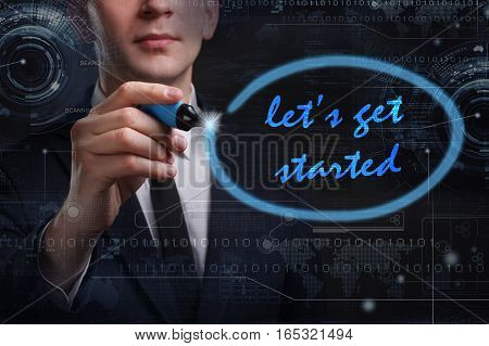 Business, Technology, Internet And Network Concept. Young Business Man Writing Word: Let's Get Start