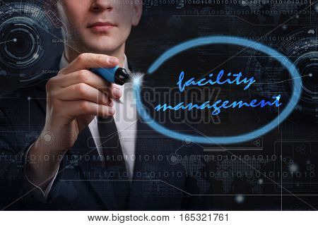 Business, Technology, Internet And Network Concept. Young Business Man Writing Word: Facility Manage