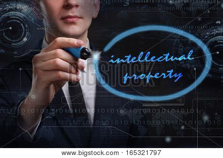 Business, Technology, Internet And Network Concept. Young Business Man Writing Word: Intellectual Pr