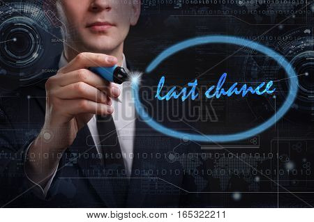 Business, Technology, Internet And Network Concept. Young Business Man Writing Word: Last Chance