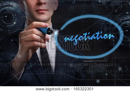 Business, Technology, Internet And Network Concept. Young Business Man Writing Word: Negotiation