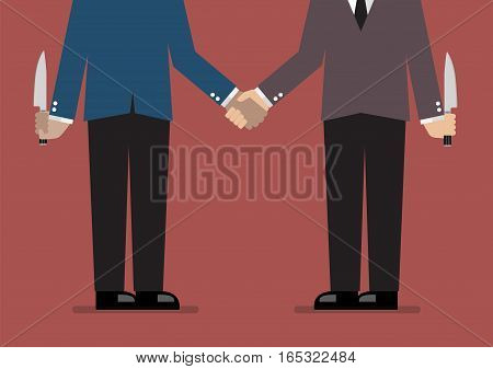 Closeup of business handshake with a knife hidden behind. Business concept