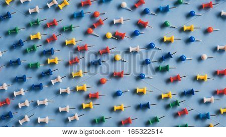 colorful pins on blue background, Adversity or unique concept, Flat lay, Top view,