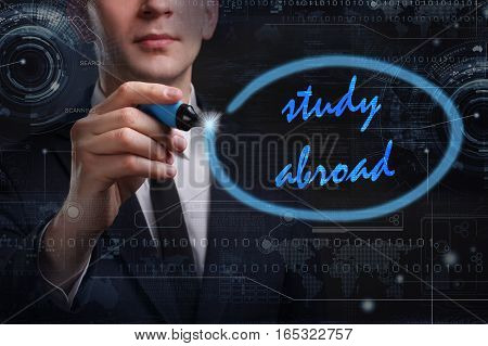 Business, Technology, Internet And Network Concept. Young Business Man Writing Word: Study Abroad