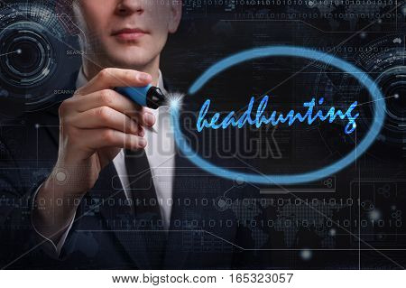 Business, Technology, Internet And Network Concept. Young Business Man Writing Word: Headhunting