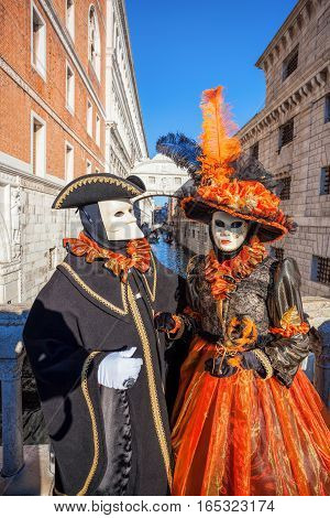 Carnival Masks Against Famous Bridge Of Sighs In Venice, Italy