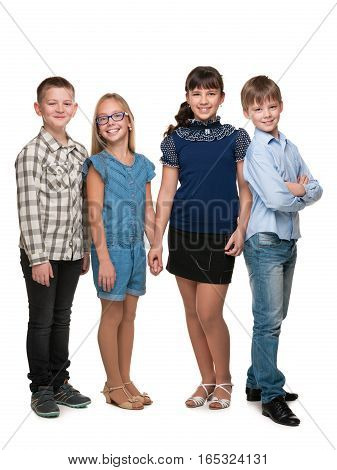 Four happy children are standing on the white background