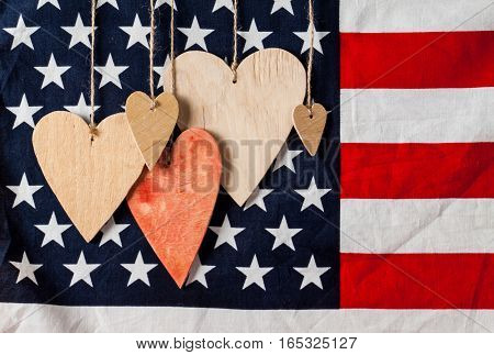 Wood hearts on american flag background. Greeting card. Valentine's day background.