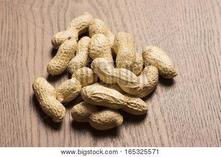 peanuts on wooden background, seed, organic, closeup