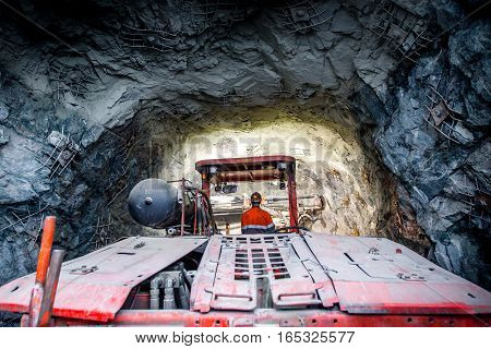 Gold mining underground. Drilling and explosive works.