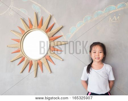 Portrait Of Asian Adorable Little Girl With The Mirror, Sun Symbol