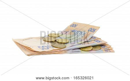 Stack of modern banknotes of Ukrainian hryvnia some of them new and several coins from above closeup on a light background