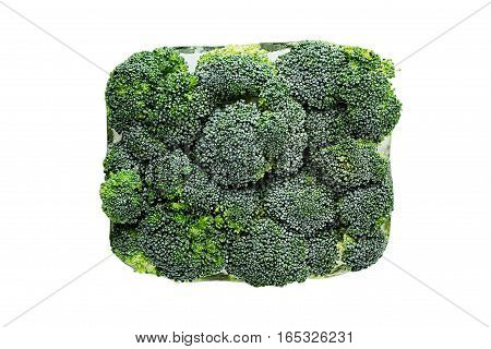Briquette of fresh frozen green broccoli with hoarfrost closeup on white background. Isolated. Healthy vitamin food.