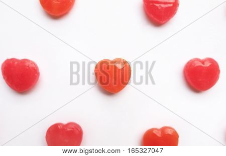 Red Valentine's day heart shape candy pattern on empty white paper background. Love Concept. colorful hipster style. Knolling top view.
