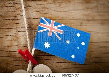 Wood heart and Australia flag on wood desk. National holiday