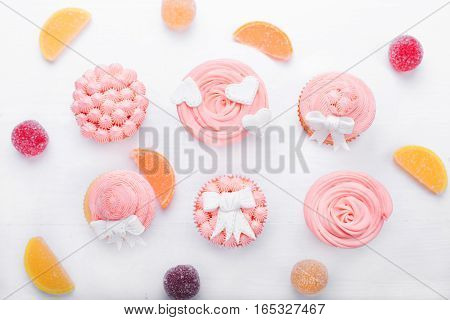 Pink cupcakes on a light background. Cupcakes