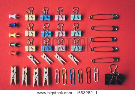 a collection of pins and paper clips