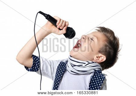 little boy sing song in microphone against white background
