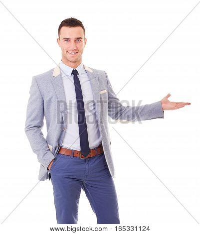 Portrait of smiling man in blue blazer showing empty copyspace
