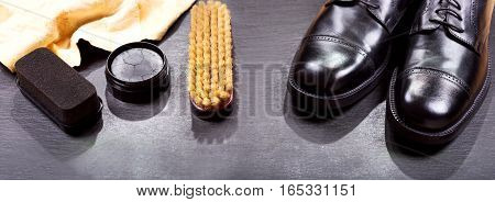 black men's shoes with care accessories banner