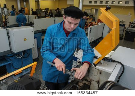 Young Turner Works On A Lathe