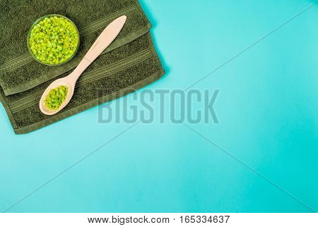 Spa set: oil, sea salt and towel. Top view. Still life. Copy space