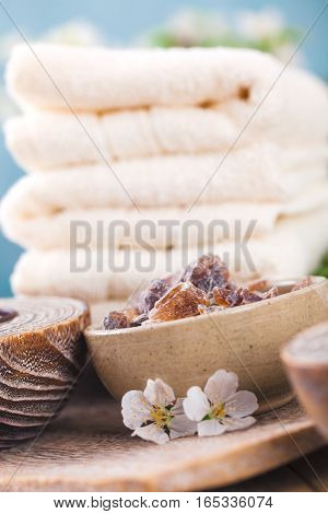 Spa and wellness setting with natural soap candles and towel. Beige dayspa nature set with copyspace