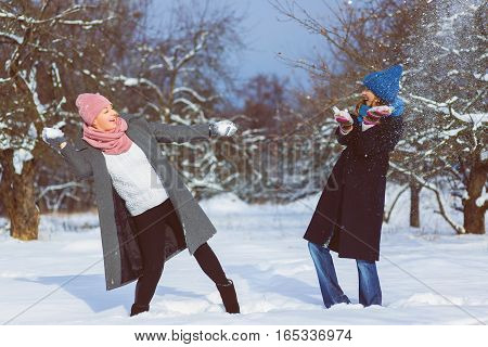 Winter portrait of fashion female friends. Affection and friendship forever Concept .