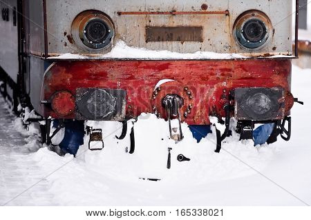 Old train locomotive stuck in train station after heavy snowfall