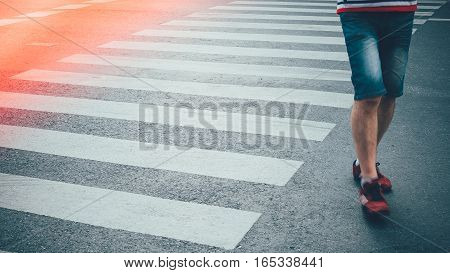 Motion Of Pedestrian Zebra Crossing Or Crosswalk In Asia. Feet Of The Pedestrians Crossing On City S