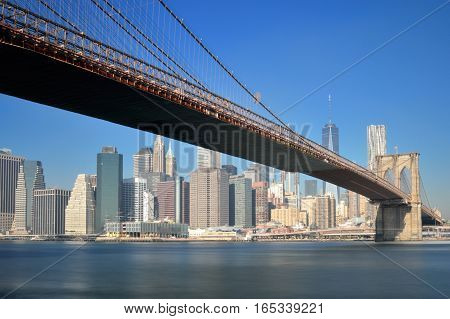 Manhattan skyline with Brooklyn Bridge - long exposure image.
