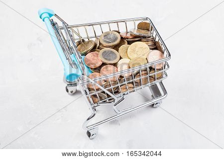 Cart With Euro Coins On Concrete Plate