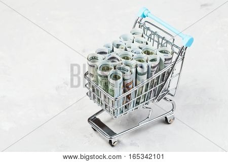 Cart With Dollar Banknotes On Concrete Board