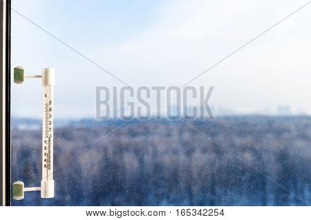 Thermometer On Window Glass In Cold Winter Day