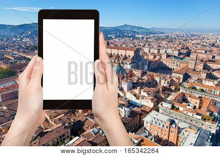 Tourist Photographs Bologna City On Tablet